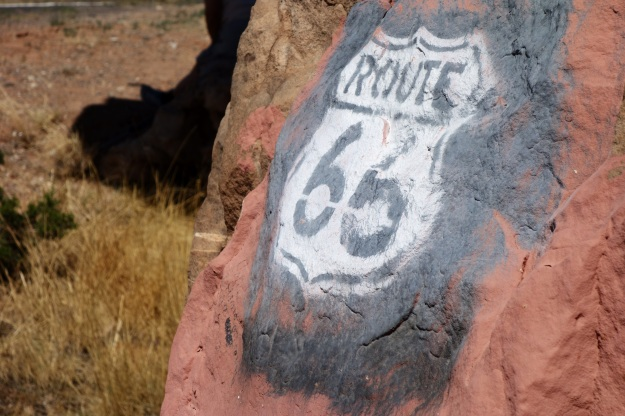 Old sign on rock along older section of Route 66